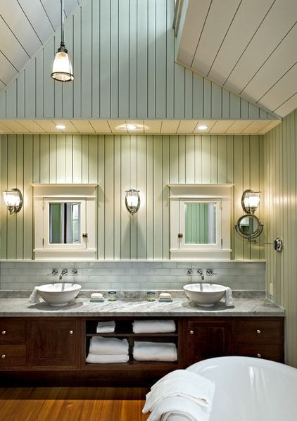 Double medicine cabinets with 3 sconces.  One pedestal sink under right cabinet; toilet under left.