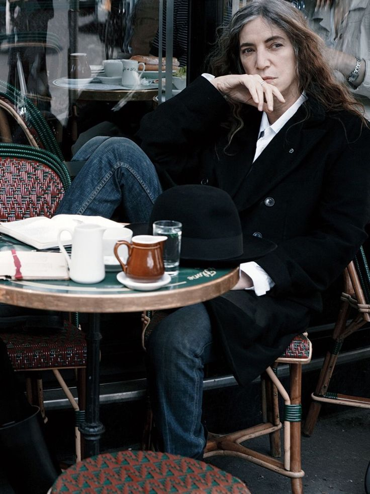 Punk rock singer, cultural agitator, writer, wife, widow, and mother Patti Smith by Annie Leibovitz. Cafe de Flore, c. 2011.