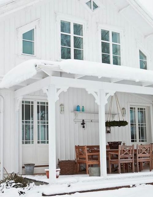 Back porch of Swedish house- from Classic Style Dream Life in the City blog.