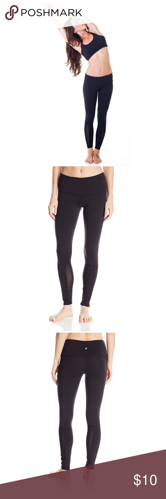 """Glyder Sheer Love Leggings Add some excitement to your workout with these sleek and stylish mesh inset leggings. The """" Sheer Love"""" legging features fierce, sheer stretch mesh vertical panels at the lower legs. The ultimate statement piece that can be worn in and out of the gym, pairs perfect with a tank and lace-up boots. Pre-loved. Very slight pilling as seen in last photo.                                                                  88% Nylon/12% Spandex  Flat seam garment construction…"""