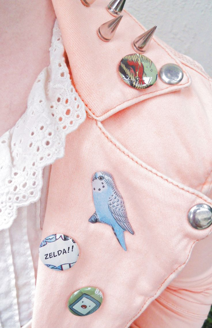 Quirky cool pins/badges on a pastel spiked leather jacket paired with a girly eyelet collar blouse = Total <3
