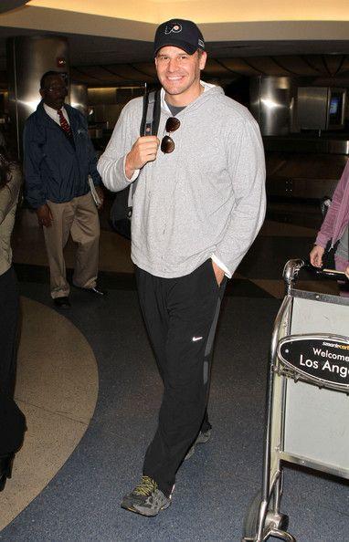 David Boreanaz Photos Photos - Actor David Boreanaz and his wife Jaime Bergman arriving on a flight at LAX airport in Los Angeles, CA. - David Boreanaz And Jaime Bergman Arriving On A Flight At LAX
