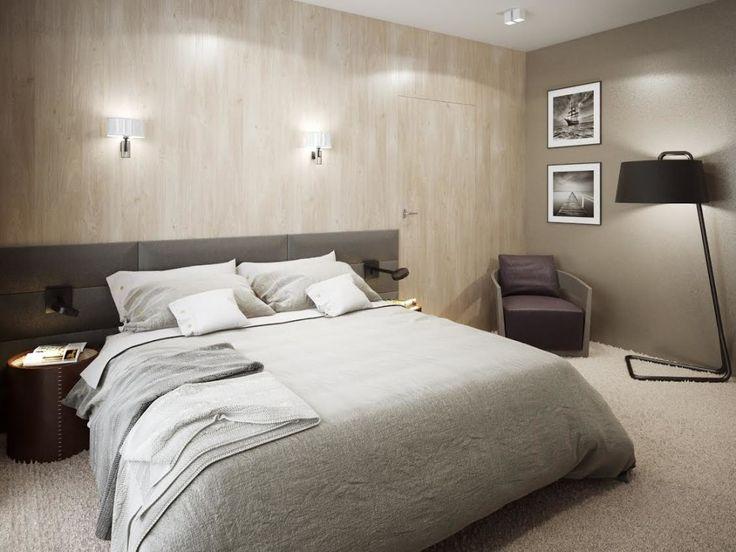 Drewniana sciana w sypialni oraz miękka wykładzina w ciepym odcieniu to elementy, które ocieplają wnętrze aranżowanej sypialni