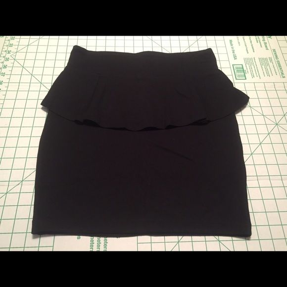 NWOT Cotton On black peplum skirt size Large NWOT black peplum skirt from Cotton On, size large. Has a zipper in the back (hard to see in pics) to help pull on/off. Stretchy and super comfy material. Cotton On Skirts