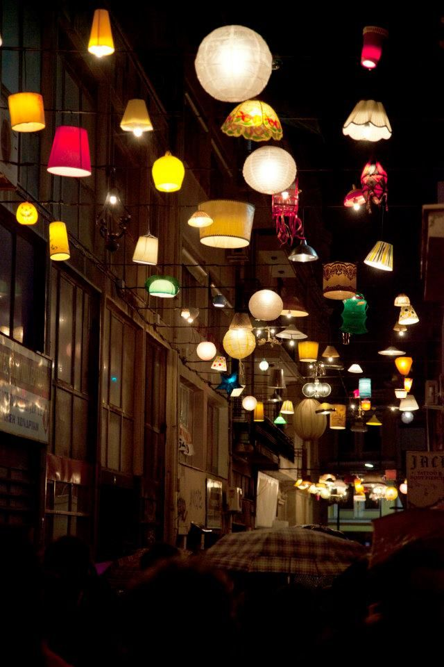 Pittaki street in Psirri: Creative studio Beforelight and the non-profit organization Imagine The City decided to bring light back to that forgotten street by creating a light installation from 150 citizens' donations of old lamp fixtures and lamp shades!