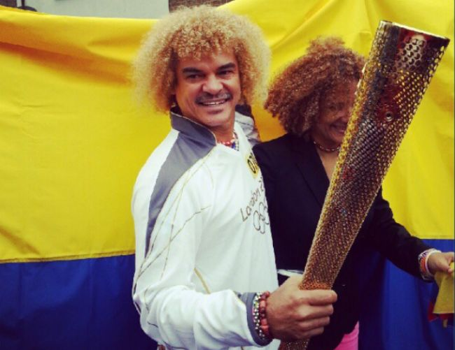 Carlos Valderrama Carries Olympic Torch Through Windsor