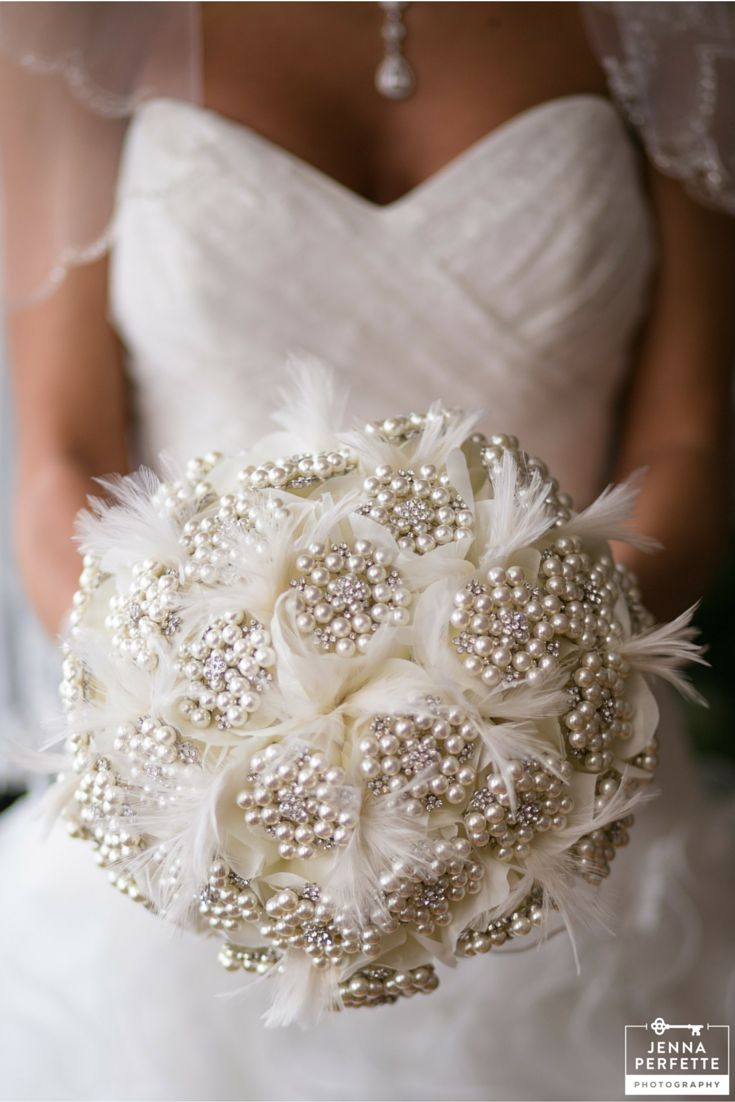 Wedding bouquet for the alternative bride who wants a flowerless bouquet. Perfect for a winter wedding - this bridal bouquet is made of snowflake like patterned pearl clusters and powdery soft feathers.
