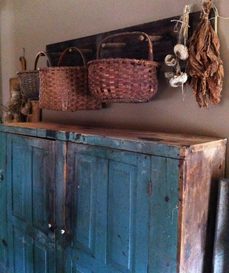 Love this blue cupboard & the baskets...