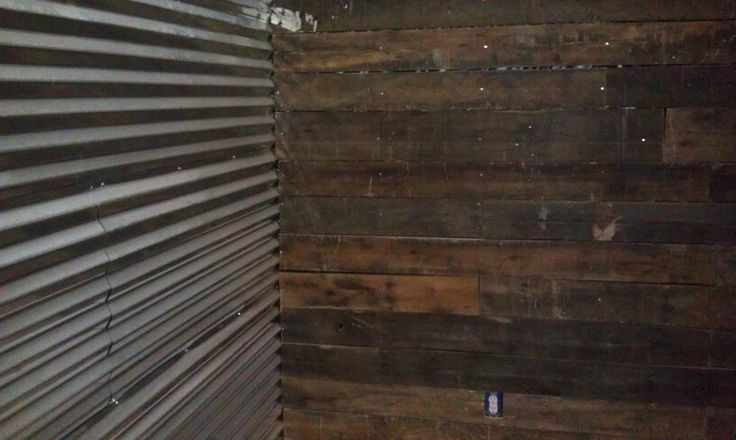 Corrugated tin wall and wood pallet wall pallet walls for Using pallets for walls