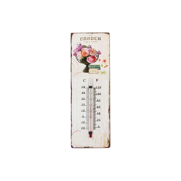 Lekko przecierany termometr z napisem Garden oraz kwiatami w wazonie, co podkreśla jego prowansalski styl. Posiada dwie skale mierzenia temperatury.
