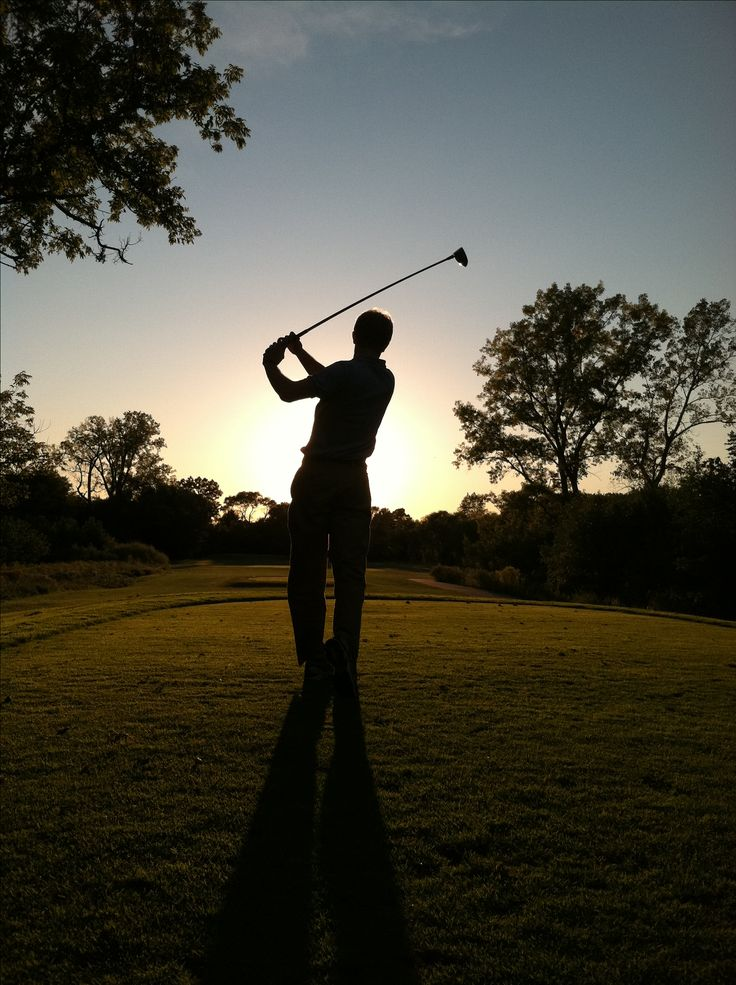 This is my friend Chipper while we were golfing for his birthday at Crane's Landing.  We were hitting directly into the sun as it was setting.  He didn't know I took the picture until I showed it to him later.  Crane's Landing Golf Course, Lincolnshire  Photo by Justin Wevers