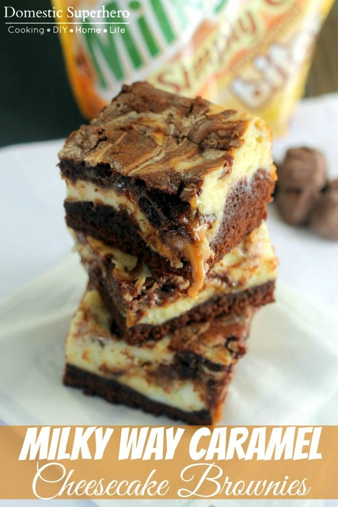 Milky Way Cheesecake Brownies are stuffed with delicious creamy cheesecake and dripping with ooey gooey caramel! These will be a hit at your next party!