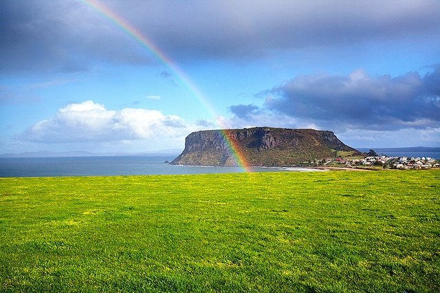 A rainbow gracing The Nut – an ancient volcanic formation overlooking the historic village of Stanley in north-west Tasmania. Photo courtesy of Dr. Kathryn Starkey.