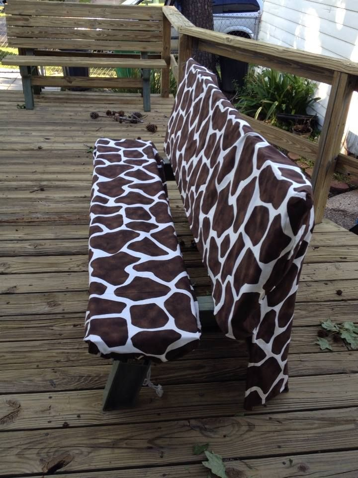 Our deck benches are older and starting to splinter, Found this material for $3 a yard on sale at Walmart -- for under twenty-five bucks made two seat covers and two slip covers for back of benches.  Use inexpensive packs of foam seat padding (4 in pack).