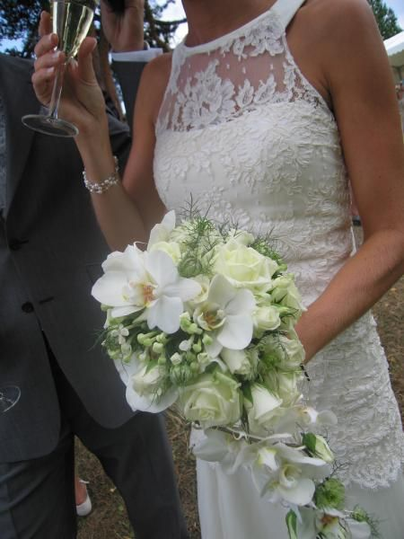 Cascade bouquet of orchid, roses and stephanotis