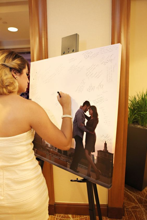"""Get a canvas done of engagement picture and have people sign for """"best wishes"""" idea or """"guest book"""""""