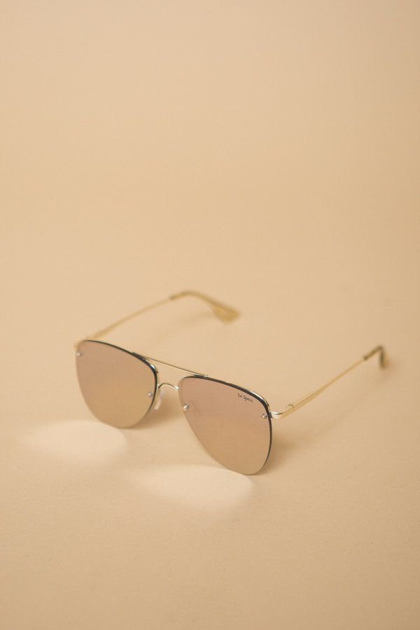Le Specs The Prince Sunglasses in gold. This futuristic update on the classic aviator from Le Specs features completely flat lenses, and spring hinges for ma...