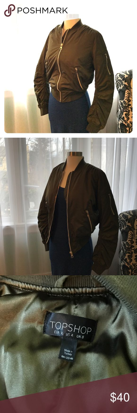Topshop Nylon Bomber Jacket Size 4 New without tags! Topshop nylon bomber in Olive Green. Size US 4. Gold zippers. Perfect Condition! Topshop Jackets & Coats
