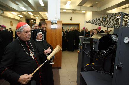Polish priest blessing a poligraph printer. Warsaw, 2009.