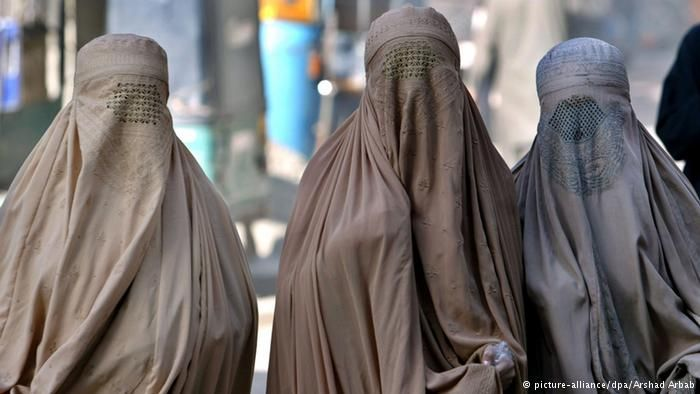 Three women in burqas. (Photo: EPA/ARSHAD ARBAB)