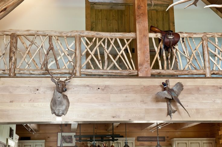 Hand crafted balcony railing.  Each locust log is hand peeled and custom placed to meet code and design satisfaction.