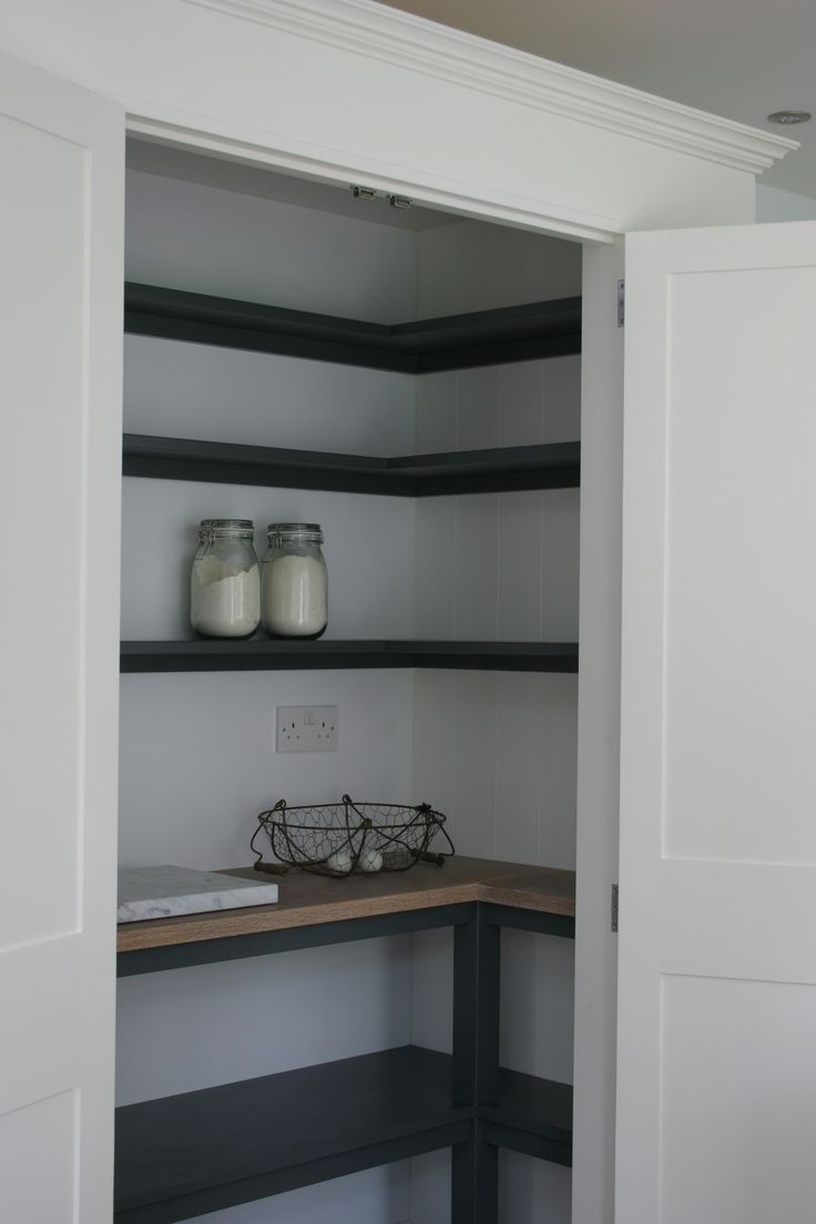 Pantry from one of our latest kitchens near Horsham , West Sussex . Painted in Farrow and Ball Wimborne White white shelving in Down Pipe and oak worktop with Osmo white oil.