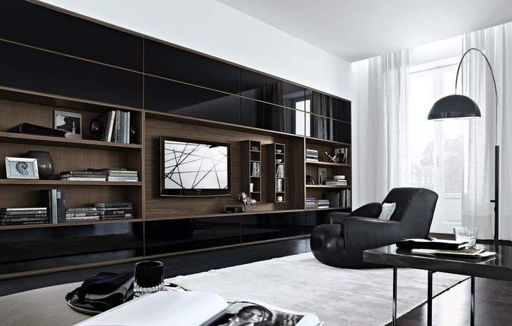 This is great inspiration for the wall unit at family room. Must design it 'warmer'…. concept is exactly what I had in mind. Poliform - Wall System