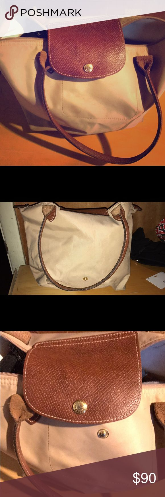 Authentic long champ bag. Cream and tan Cream and tan Long Champ bag. No trades. Authentic. Love condition. Signs of wear. Handles are intact and good condition. Obo. Longchamp Bags Shoulder Bags