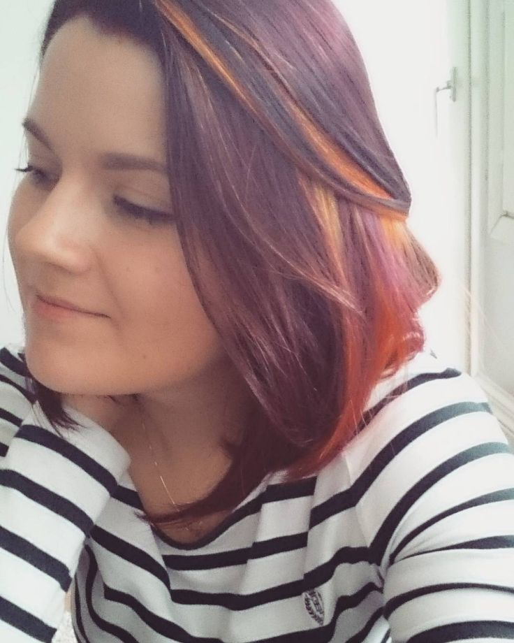 bright spring colours. red hair with orange, purple and yellow highlights but it still looks subtle