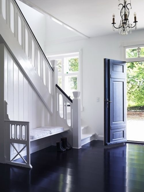 Black & White + staircase railing + door + entry bench .