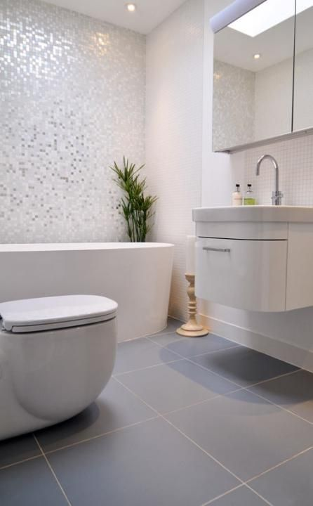 white bathroom - like the floor and small tile in tub area