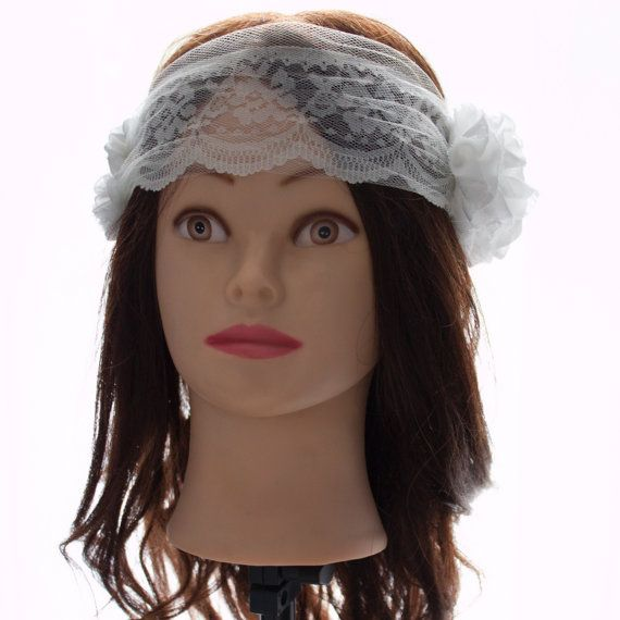Lace and Tulle tied headband. With Chiffon Flowers and small pearl accents on one side. Available in White or Ivory.