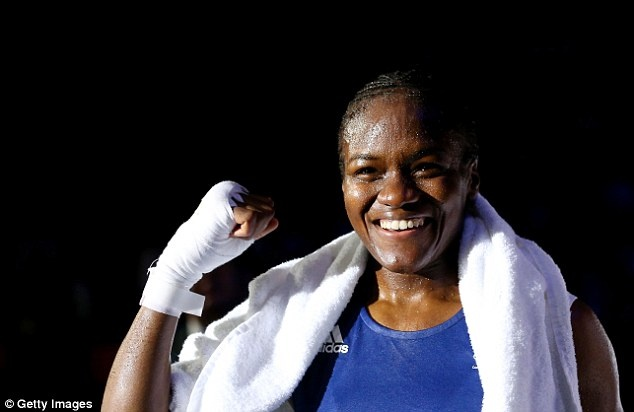 Nicola Adams of Team GB wins the 1st ever women's Olympic boxing gold medal. (via Daily Mail; photo via Getty Images)