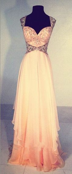 Stunning side cut out dress. Feminine and flowy. I'd feel like a princess in this dress. To the ball we go!