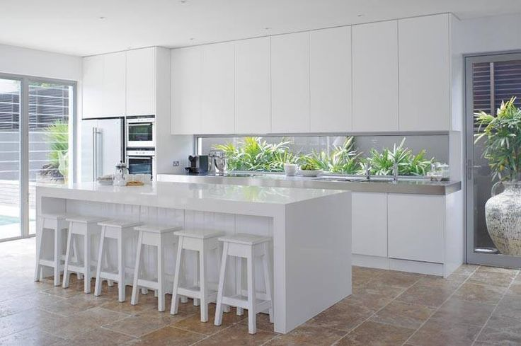 White kitchen with window splashback.