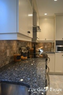 blue pearl granite countertop and tumbled marble backsplash