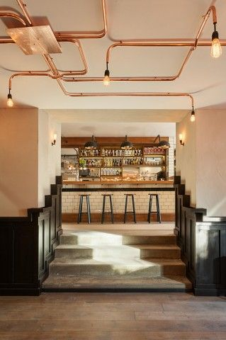 Cafe De Ebeling - Asterdam via framework - cooper pipe ceiling lighting...crushing on ceiling piping, etc!