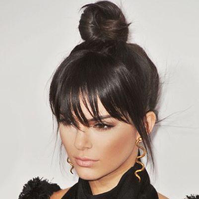 Kendall Jenner left us all with hair goals at the AMA's! We are loving her messy top bun with bangs! We think Kendall rocks this look and she's aware that her fans LOVE to see her in bangs! She mentioned it in a recent epsiode of Keeping Up With the Kardashians! It's an easy look to get Glitter Girls! Just Swoop your hair in a simple top knot and make sure to part your hair for bangs at the start. You only need a little heat and protectant to give your bangs a slight curve over your brow…