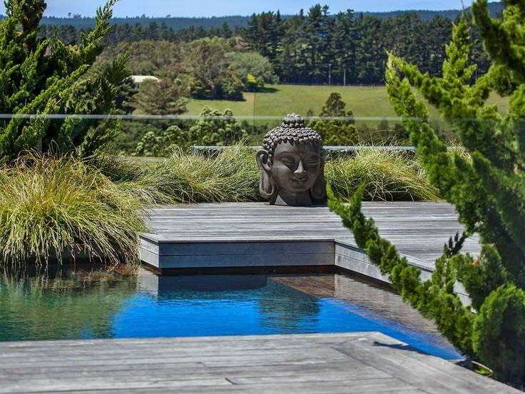 Contemporary Home in New Zealand Buddha statue