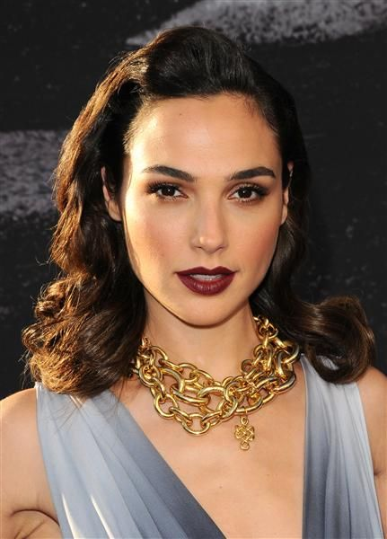 """""""Fast & Furious 6"""" star Gal Gadot looked glamorous and on trend with her merlot-colored lip and a big gold chunky necklace."""
