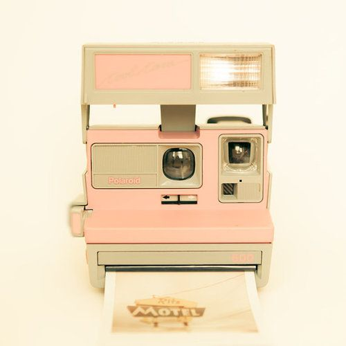 Pink Polaroid Camera. Ours wasn't pink, but we had a Polaroid