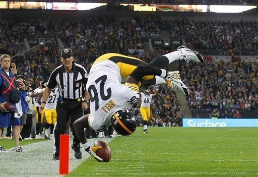 Le'Veon Bell flips over as he scores a touchdown during the NFL football game against Minnesota Vikings at Wembley Stadium, London, Sunday, ...