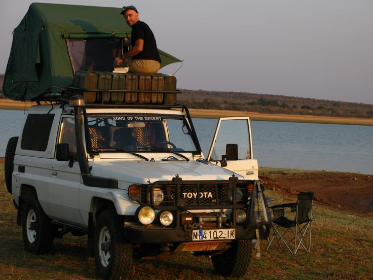 A roof tent, a lake and an African sunset. What else may you wish?. Southafrica ehading to Bostwana.