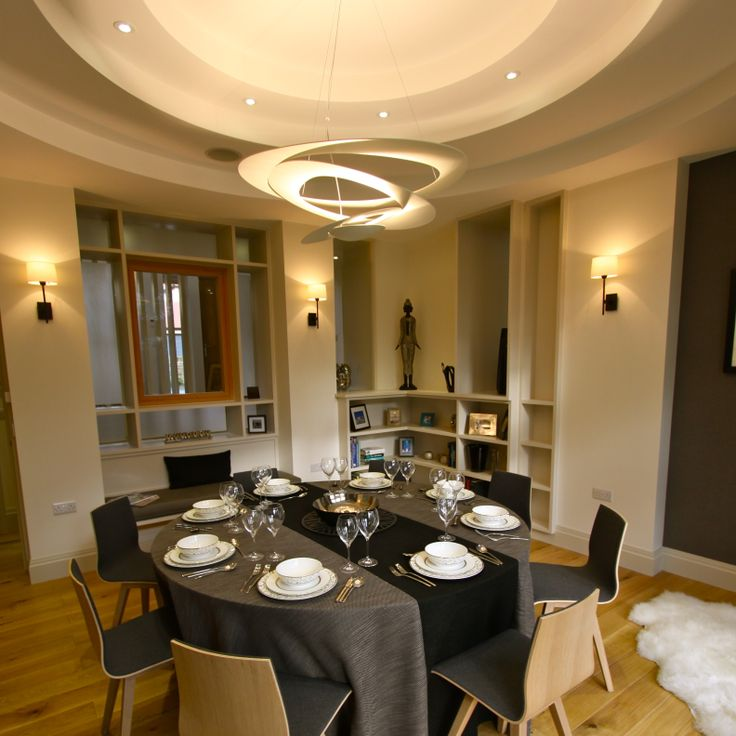 Elegant Dining room by One 17. Circular profiled ceiling. Circular dining table. Artemide Pirce pendant.
