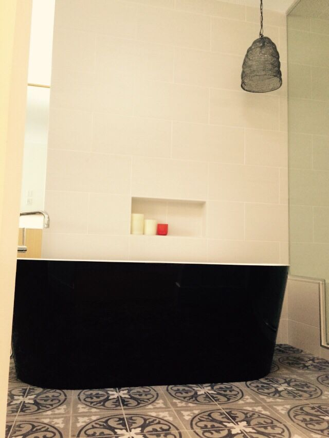 Time to relax...Portuguese hand painted cement tiles, black tub