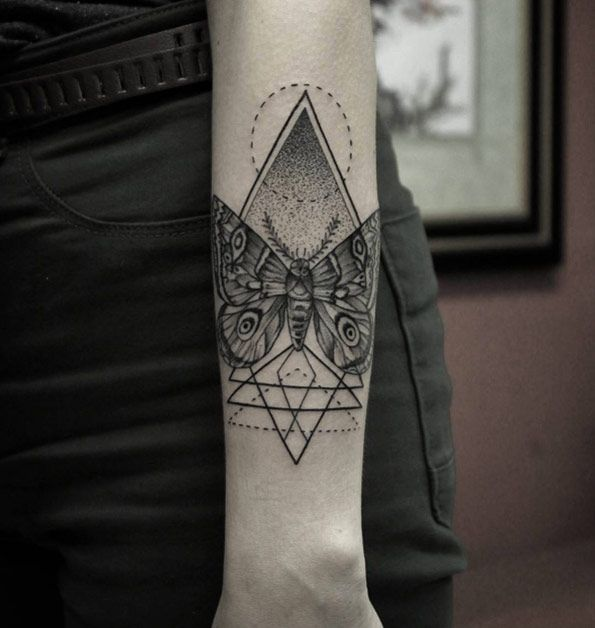 Geometric butterfly tattoo by Marquinho Andre