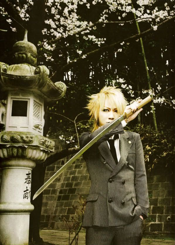 Just Ruki being a badass in a suit with a sword. ♥