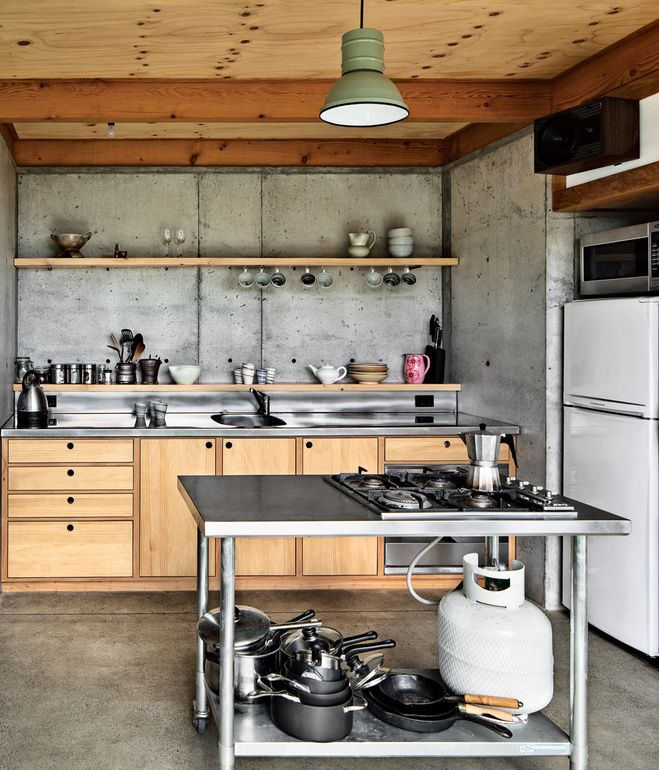 The designers fabricated everything in the house, down to the quarter-sawn pine and macrocarpa-wood kitchen cabinetry and concrete floor....