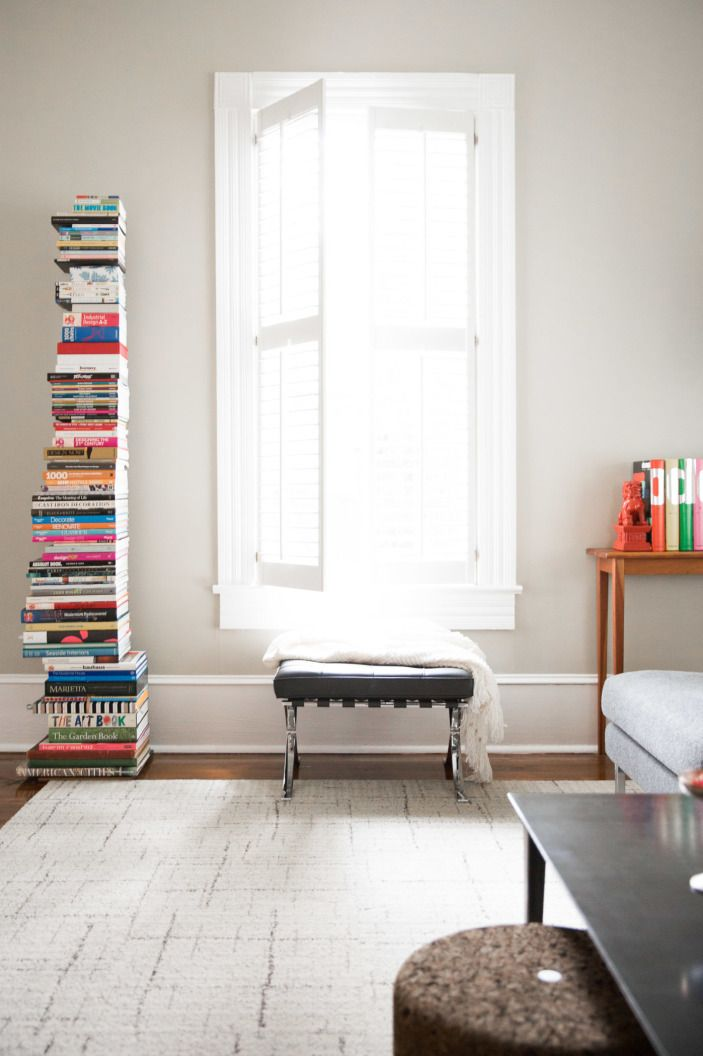 """As Diane says, """"I collect art & design books, and in an older home that lacked storage, a vertical <a href=""""http://www.dwr.com/product/sapien-bookcase-short.do?adpos=1o1&creative=48777441399&device=c&matchtype=&network=g&gclid=CPHgvcGAqsoCFdgQgQodnLoEog"""" target=""""_blank"""">bookshelf</a> was the solution. the genius design has a hidden steel spine and a very small footprint. But the almost seven-foot-tall off-set stack makes people uneasy, thinking it might topple over."""""""