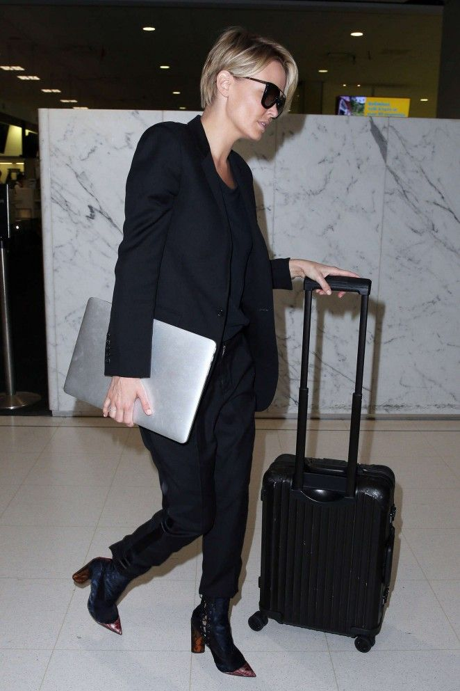 Lara Bingle at Sydney Airport -06